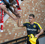 Football: Test Match, Liverpool FC - Borussia Dortmund. Liverpool fans reach out to shake the hand of Dortmund's Thorgan Hazard before their exhibition match on July 19, 2019 at Notre Dame Stadium. <br /> Tim Vizer/DPA