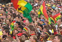 Germany, DEU, Dortmund, 2006-Jun-27: FIFA football world cup (USA: soccer world cup) 2006 in Germany; fans of the Ghanaian national football team waving their flags in a public viewing area before the world cup match Brazil vs. Ghana (3:0).