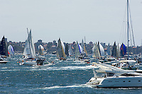 Just seconds after the starting gun, the competitors in the annual Sydney to Hobart yacht race dash up Sydney Harbour surrounded by spectators' boats.