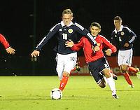 John Herron and Sergis Shahinyan challenge in the Scotland v Armenia UEFA European Under-19 Championship Qualifying Round match at New Douglas Park, Hamilton on 9.10.12.