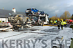 Castleisland Fire fighters tackle a car loader that caught fire on the at Dysert bridge Castleisland on Tuesday morning