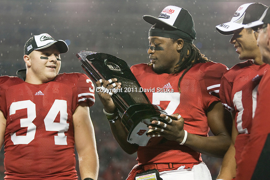 Wisconsin Badgers defensive back Aaron Henry (7) holds the Leaders Division Trophy after an NCAA Big Ten Conference college football game against the Penn State Nittany Lions on November 26, 2011 in Madison, Wisconsin. The Badgers won 45-7. (Photo by David Stluka)