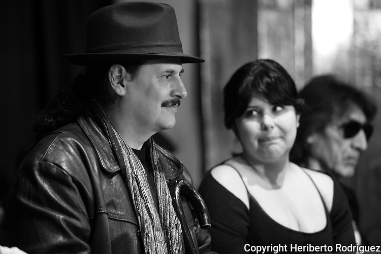 "Blues music player Jose Cruz (L) smiles while his daughter and lead singer Maria Jose Camargo and guitar player Sergio Mancera look on during a press conference to announce the music concert ""A lesson of life"", and the release of the CD on January 29. Jose Cruz has a long career as a music player who plays blues in spanish. Photo by Heriberto Rodriguez"