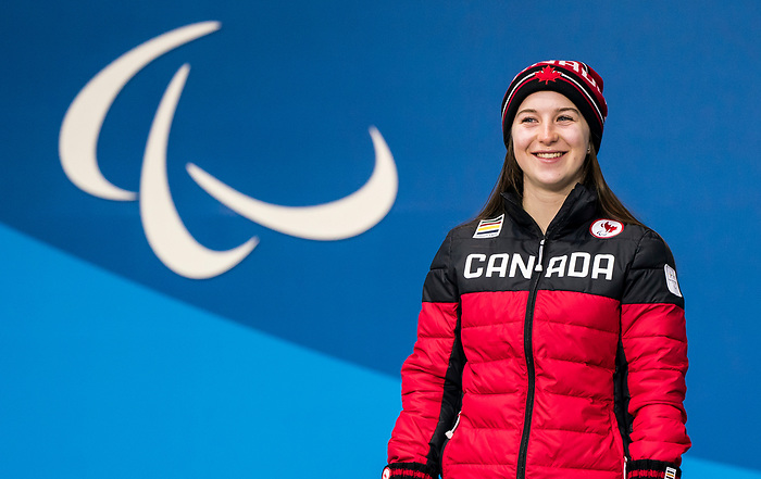 PyeongChang 10/3/2018 - Mollie Jepsen collects her bronze medal in the women's standing downhill during the medal ceremony at the PyeongChang Olympic Plaza during the 2018 Winter Paralympic Games in Pyeongchang, Korea. Photo: Dave Holland/Canadian Paralympic Committee