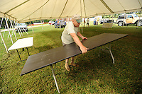 NWA Democrat-Gazette/ANDY SHUPE<br /> Tom Pennel of Cane Hill, event chairman for the Cane Hill Harvest Festival, assembles tables Wednesday, Sept. 16, 2015, in preparation for this weekend's 29th annual festival in Cane Hill. The event features music, games, a country breakfast, antique tractor and quilt shows, and demonstrations of sorghum molasses production Saturday and Sunday.
