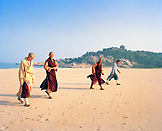 CHINA, Putou Shan, monks walk Thousand Steps Beach on the island of Putou Shan
