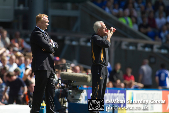 Birmingham City 1 Wolverhampton Wanderers 1, 01/05/2011. St Andrews, Premier League. Visiting manager Mick McCarthy (right) becomes animated in the first half at St. Andrew's stadium, during Birmingham City's Barclay's Premier League match with Wolverhampton Wanderers as home manager Alex McLeisdh looks on. Both clubs were battling against relegation from  England's top division. The match ended in a 1-1 draw, watched by a crowd of 26,027. Photo by Colin McPherson.