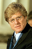 Robert Redford listens  to remarks during the National Medal of Arts ceremony in the Andrew W. Mellon Auditorium in Washington, D.C. on January 9, 1997..Credit: Ron Sachs / CNP