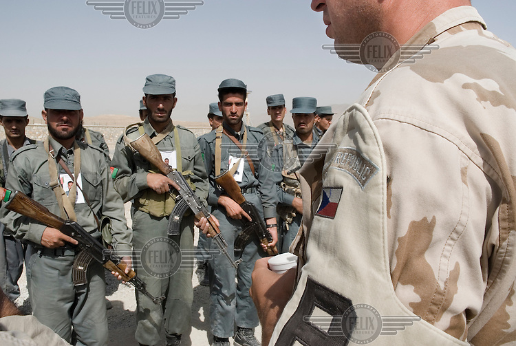 A Czech military policeman trains officers from the ANAP (Afghan National Auxiliary Police) at the police academy inside FOB Shank.