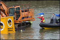 BNPS.co.uk (01202 558833)<br /> Pic: GrahamHunt/BNPS<br /> <br /> That's embarrassing - Crowds gathered yesterday to watch the red faced attempts to retrieve the digger.<br /> <br /> Time and tide waits for no 'work'men.<br /> <br /> Red faced workmen had to abandon their digger as the tide rushed in to West Bay harbour in Dorset yesterday - despite desperate attempts to  rescue it the tide overwelmed their efforts.