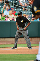 Umpire Ramon DeJesus handles the calls on third base during the Pacific Coast League game between the Salt Lake Bees and the Reno Aces at Smith's Ballpark on July 23, 2014 in Salt Lake City, Utah.  (Stephen Smith/Four Seam Images)