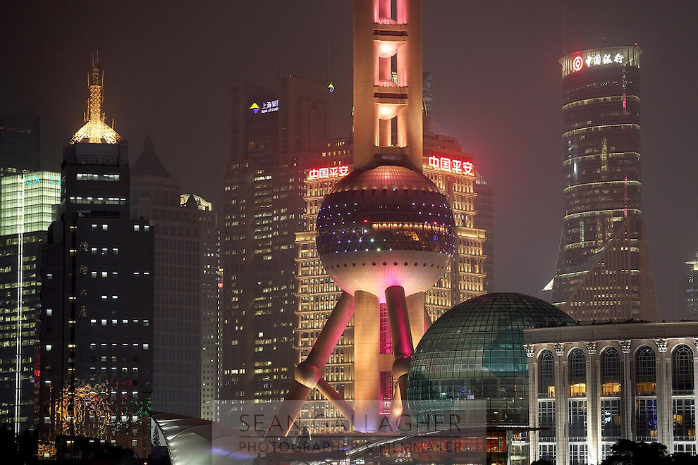 The Oriental Pearl Tower and the distinctive Pudong skyline at night, 2014.<br />