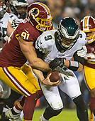 Washington Redskins outside linebacker Ryan Kerrigan (91) sacks Philadelphia Eagles quarterback Nick Foles (9) in the fourth quarter of their game at FedEx Field in Landover, Maryland on December 30, 2018.  The Eagles won the game 24 - 0 and their victory coupled with the Viking loss allowed them to advance to the NFC playoffs.<br /> Credit: Ron Sachs / CNP