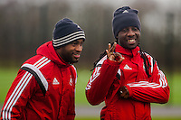 SWANSEA, WALES - JANUARY 28:  ( L-R )  Dwight Tiendalli of Swansea City and Marvin Emnes of Swansea City play to the camera before training  on January 28, 2015 in Swansea, Wales.