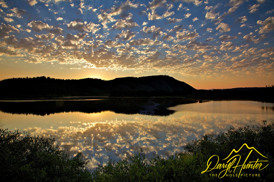Altocumulus clouds at sunrise over Grand Teton National Park's Oxbow Bend.<br />