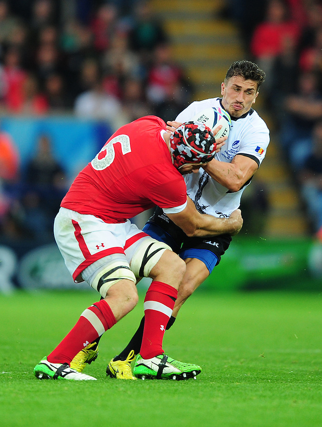 Romania's Ionut Botezatu is tackled by Canada's Jebb Sinclair<br /> <br /> Photographer Chris Vaughan/CameraSport<br /> <br /> Rugby Union - 2015 Rugby World Cup Pool D - Canada v Romania - Tue 6 October 2015 - King Power Stadium, Leicester <br /> <br /> &copy; CameraSport - 43 Linden Ave. Countesthorpe. Leicester. England. LE8 5PG - Tel: +44 (0) 116 277 4147 - admin@camerasport.com - www.camerasport.com
