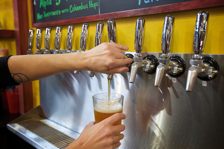 NEW YORK, NY - April 22, 2016: The ribbon cutting ceremony marking the opening of The Chelsea Craft Brewing Company, which recently relocated to The Bronx. <br /> <br /> CREDIT: Clay Williams for Edible Bronx<br /> <br /> &copy; Clay Williams / claywilliamsphoto.com
