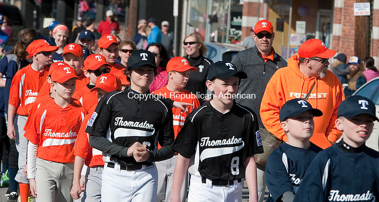 THOMASTON,  CT--- -041616JS06--Members of the Thomaston Little League make their way from Seth Thomas Park to Reeves Field in Thomaston during the annual parade on Saturday. <br /> Jim Shannon Republican-American