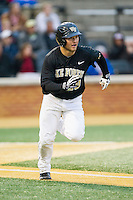 Nate Mondou (10) of the Wake Forest Demon Deacons hustles down the first base line against the Florida State Seminoles at Wake Forest Baseball Park on April 19, 2014 in Winston-Salem, North Carolina.  The Seminoles defeated the Demon Deacons 4-3 in 13 innings.  (Brian Westerholt/Four Seam Images)