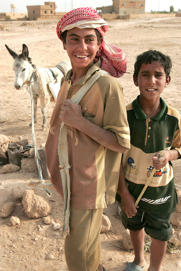 A pair of Iraqi boys and their donkey on the outskirts of Haditha, Iraq on Tuesday, Oct. 11 2005.