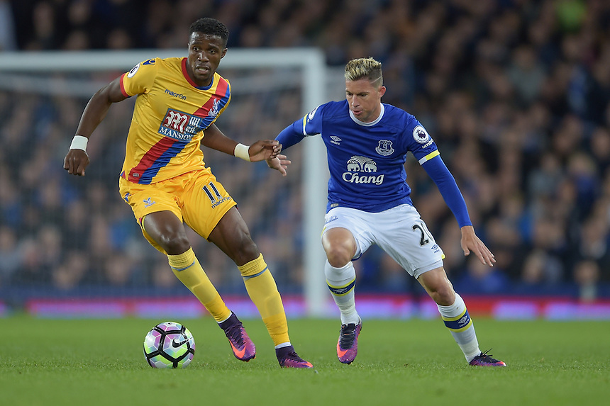 Crystal Palace's Wilfried Zaha vies for possession with Everton's Bryan Oviedo<br /> <br /> Photographer Terry Donnelly/CameraSport<br /> <br /> The Premier League - Everton v Crystal Palace - Friday 30th September 2016 - Goodison Park - Liverpool<br /> <br /> World Copyright &copy; 2016 CameraSport. All rights reserved. 43 Linden Ave. Countesthorpe. Leicester. England. LE8 5PG - Tel: +44 (0) 116 277 4147 - admin@camerasport.com - www.camerasport.com