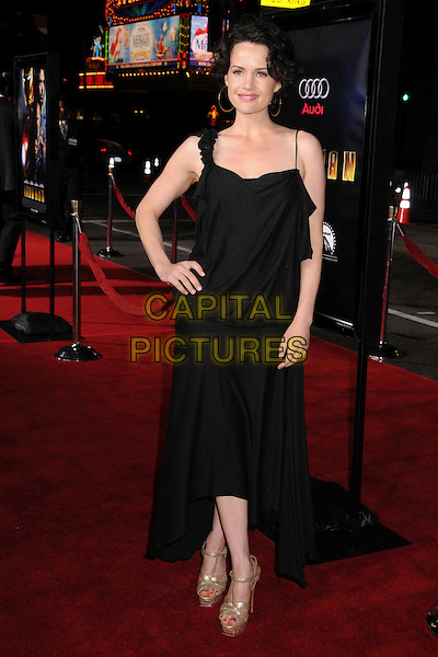 """CARLA GUGINO .""""Iron Man"""" Los Angeles Premiere at Grauman's Chinese Theatre, Hollywood, California, USA,.30 April 2008..full length black dress hand on hip long  gold platform shoes strappy  .CAP/ADM/BP.©Byron Purvis/Admedia/Capital PIctures"""