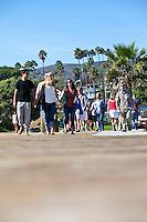 Visitors Walking On The Boardwalk At Main Beach In Laguna Beach California