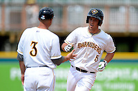 Bradenton Marauders catcher Jacob Stallings #5 is congratulated by manager Frank Kremblas #3 while running the bases after hitting a home run during a game against the Fort Myers Miracle at McKechnie Field on April 7, 2013 in Bradenton, Florida.  Fort Myers defeated Bradenton 9-8 in ten innings.  (Mike Janes/Four Seam Images)
