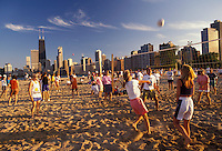 AJ2789, Chicago, volleyball, skyline, Illinois, People playing volleyball games on the beach along Lake Michigan at North Avenue Park with skyline of downtown Chicago in the background in the state of Illinois.