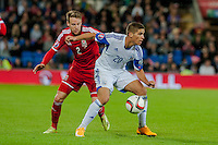 Wednesday 4th  December 2013 Pictured: ( l-r )  Chris Gunter of Wales tries to tackle Pieros Sotiriou of Cyprus  <br /> Re: UEFA European Championship Wales v Cyprus at the Cardiff City Stadium, Cardiff, Wales, UK