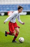 29 APR 2009 - LONDON,GBR - Ruth Sutcliffe - Leeds Met Carnegie (green and purple) v Northumbria University (white and red) - BUCS Womens Football Championships '09. (PHOTO (C) NIGEL FARROW)