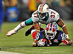 7 December 2008: Buffalo Bills' running back Marshawn Lynch is tackled by Miami Dolphins safety Yeremiah Bell short of first down yardage during the first regular season NFL game ever played in Canada. The Dolphins defeated the Bills 16-3 at the Rogers Centre in Toronto, Ontario. ..Mandatory Photo Credit: Ed Wolfstein Photo