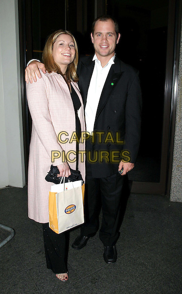 KYREN BRACKEN & WIFE.Matt Dawson testimonial dinner in aid of NSPCC charity at the Royal Lancaster Hotel .27/11/2003.rugby player, goodie bag, goody bag.www.capitalpictures.com.sales@capitalpictures.com.© Capital Pictures.