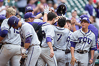 Josh Watson (7) of the Texas Christian Horned Frogs is congratulated by his teammates after hitting a home run against the Houston Cougars in game eight of the Shriners Hospitals for Children College Classic at Minute Maid Park on February 28, 2016 in Houston, Texas.  The Horned Frogs defeated the Cougars 10-1.  (Brian Westerholt/Four Seam Images)