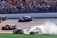 The race cars of Michael Waltrip(#7) Robby Gordon (in smoke) and Stacy Compton (#9) crash during the running of the Diehard 500 NASCAR race at Talladega, AL 4/16/00.(Photo by Brian Cleary)