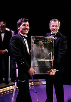 November 16 1986 File Photo - Montreal, Quebec - Handicaped athlete  Andre Viger (L) honored at La Presse (newpaper) annual gala by Roger D. landry, publisher of La Presse