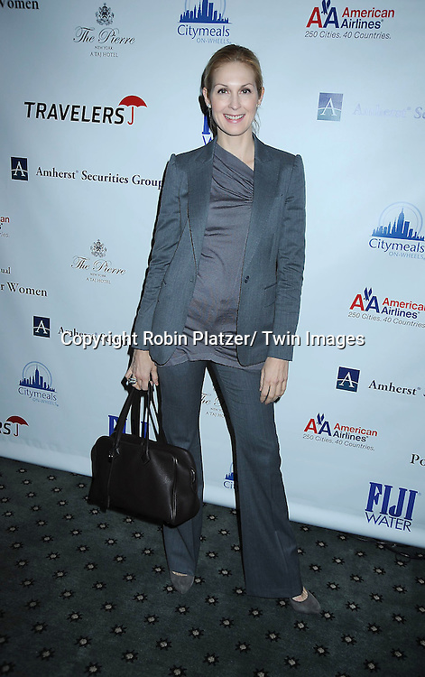 Kelly Rutherford posing for photographers at The 24th Annual Citymeals-on-Wheels Power Lunch for Women on November 12, 2010 at The Pierre Hotel in New York City.