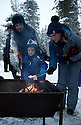 03/12/15<br /> <br /> Tel: 07734 603843.  <br /> <br /> The Julian family from Derby: Ethan, Nadine and Nick.  Roasting Marsh Mallows on a log fire.<br /> <br /> <br /> Sick children are flown from East Midlands Airport to visit Santa and spend the day in Lapland. When You Wish Upon A Star have been arranging these festive flights for 24 years.<br />  <br /> All Rights Reserved: F Stop Press Ltd. +44(0)1335 418365   +44 (0)7765 242650 www.fstoppress.com