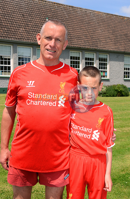 Liverpool fans Liam Mulligan and his Dad Dave at the St. Patrick's N.S. 7K walk for Alice. www.newsfile.ie