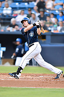 Asheville Tourists first baseman Tyler Nevin (23) swings at a pitch during a game against the Rome Braves at McCormick Field on July 27, 2017 in Asheville, North Carolina. The Braves defeated the Tourists 6-3. (Tony Farlow/Four Seam Images)