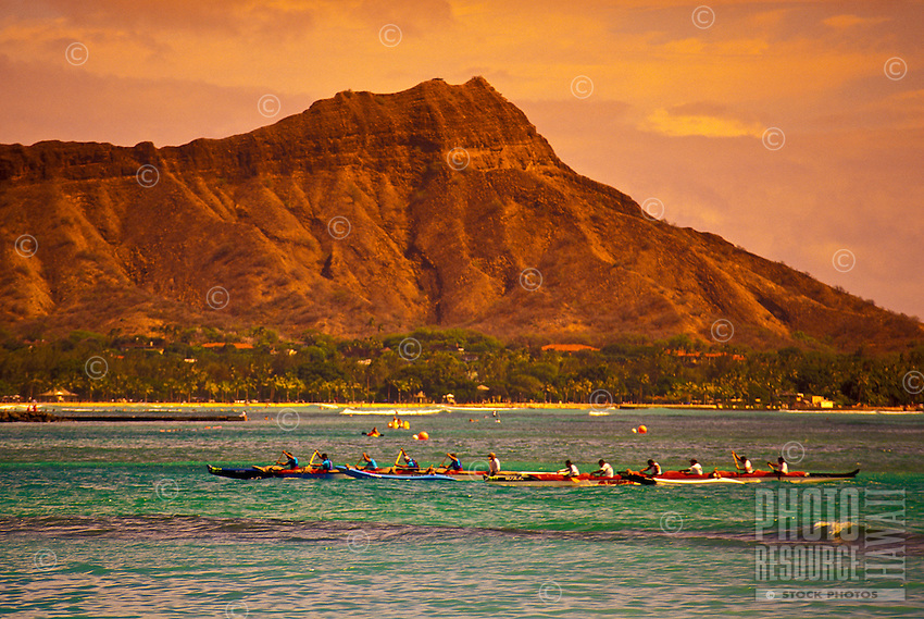 Outrigger canoe teams race past Diamond Head to Waikiki Beach.