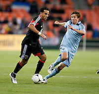 Dwayne De Rosario, Matt Besler.  Sporting KC defeated D.C. United, 1-0, at RFK Stadium in Washington, DC.