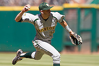 Baylor Bears shortstop Jake Miller #24 prepares to throw to first during the NCAA baseball game against the California Golden Bears on March 1st, 2013 at Minute Maid Park in Houston, Texas. Baylor defeated Cal 9-0. (Andrew Woolley/Four Seam Images).