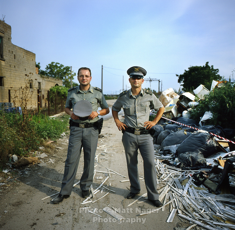 Francesco Cipolletta (cq, left) and Umberto Del Pesce (cq), agents with Corpo Forestale dello Stato, the federal forestry department, stand after marking and documenting a found urban waste pile in the countryside between Nola and Marigliano, Italy, Saturday, July 3, 2010. The Corpo Forestale dello Stato is a government agency in charge of running missions documenting actual illegal waste disposal and securing found waste sites. These sites often take years to be cleaned up and disposed of due to bureaucratic hold ups. ..PHOTOS/ MATT NAGER