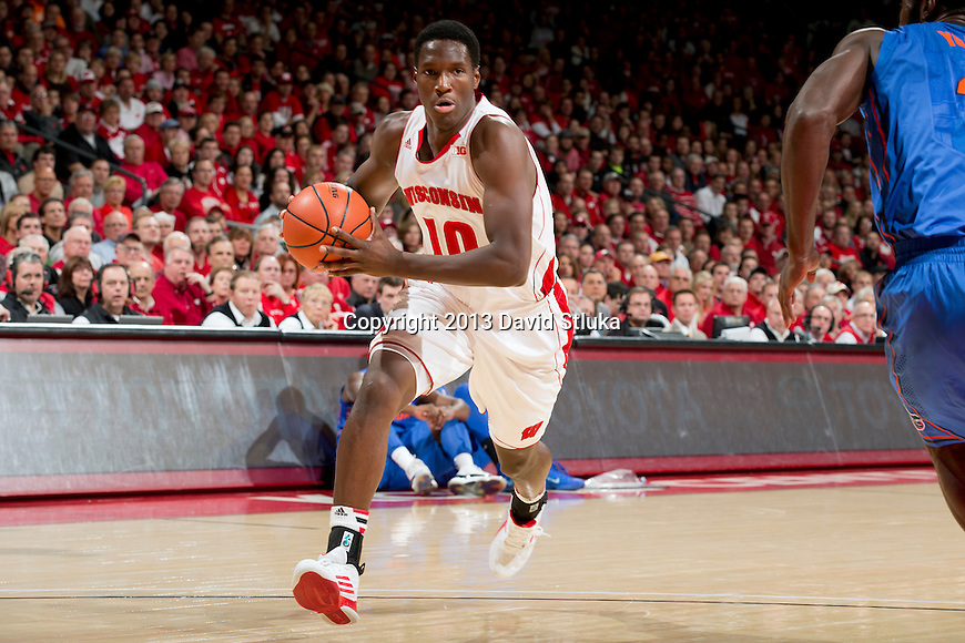 Wisconsin Badgers forward Nigel Hayes (10) drives to the basket during an NCAA college basketball game against the Florida Gators Tuesday, November 12, 2013, in Madison, Wis. The Badgers won 59-53. (Photo by David Stluka)