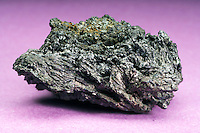CHALCOCITE<br /> Copper Sulfide<br /> (Variations Available).<br /> Cu2S. MW = 159.16 gm<br /> An important copper mineral ore due to high copper content, but not primary due to its scarcity.  From  Greek chalkos = copper. Crystal form is monoclinic, prismatic but forms pseudomorphs of many  copper minerals. Ladysmith Mine, Rusk Co.,WI.