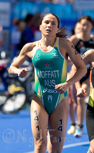 21 JUL 2013 - HAMBURG, GER - Emma Moffatt (AUS) of Australia begins her first run lap during the ITU 2013 Mixed Relay Triathlon World Championships in the Altstadt Quarter in Hamburg, Germany (PHOTO COPYRIGHT © 2013 NIGEL FARROW, ALL RIGHTS RESERVED)