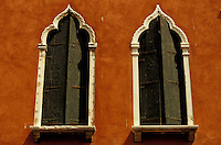 Double windows in red facade.
