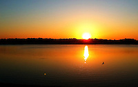 Jul 21, 2011; Holland, OH, USA; The sun rises over Hidden Harbor Lake on the hottest day of the year in Northwest Ohio. Temperatures are suppose to reach 101 degrees. Mandatory Credit: Andrew Weber..