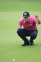Wu Ashun (CHN) on the 9th green during Thursday's Round 1 of the 2014 BMW Masters held at Lake Malaren, Shanghai, China 30th October 2014.<br /> Picture: Eoin Clarke www.golffile.ie